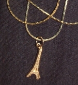 "EIFFEL TOWER PENDANT NECKLACE - Vintage Gold-tone Genuine Pressed Stamped Brass Dimensional Charm - Approx. 3/8"" Wide x 3/4"" Long, on 18"" Gold-tone Neck Chain. How very French of you to wear this! When's the last time YOU saw Paris???"